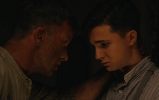 Wilfred comforts Henry after their ordeal in 1922
