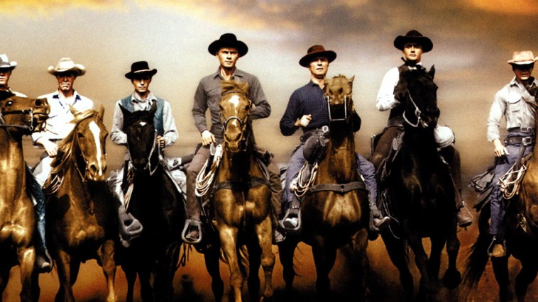7 cowboys riding on horses