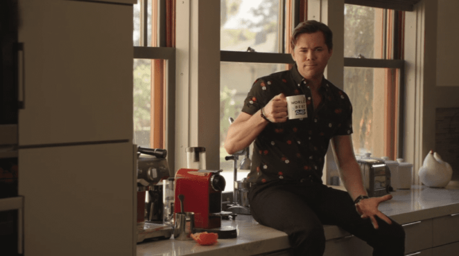 "David Patton (Andrew Rannells) drinks from Alex Myers' (Ron Livingston) World's Best Dad mug while talking to him The Romanoffs ""Bright and High Circle"""