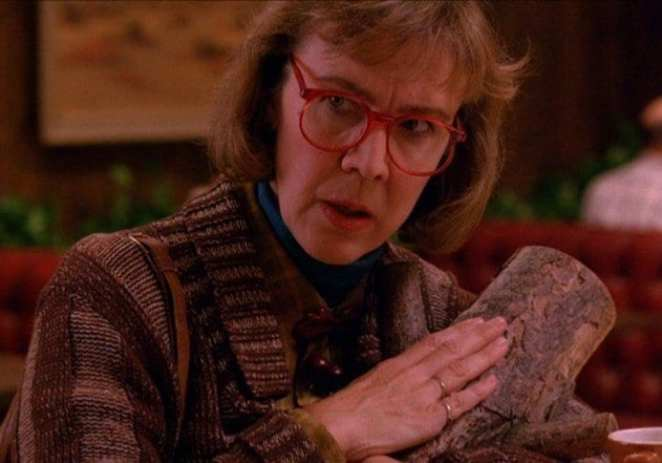 The Log Lady, with the log.