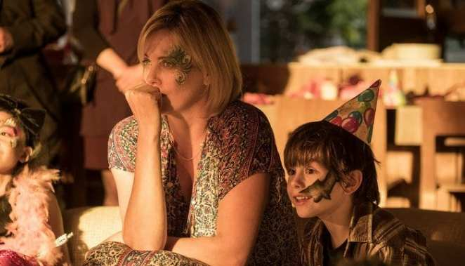 Charlize Theron with her face painted at a childrens party in Tully