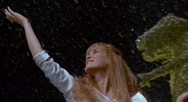 Kim dances in the snow as Edward carves a snow angel.