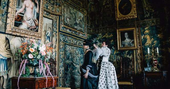 Queen Anne ties Lady Sarah´s blindfold in one of the many opulent chambers of The Favourite.