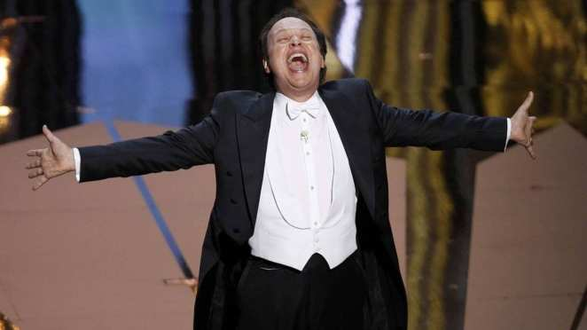 Host Billy Crystal performs onstage during the 84th Annual Academy Awards in 2012.