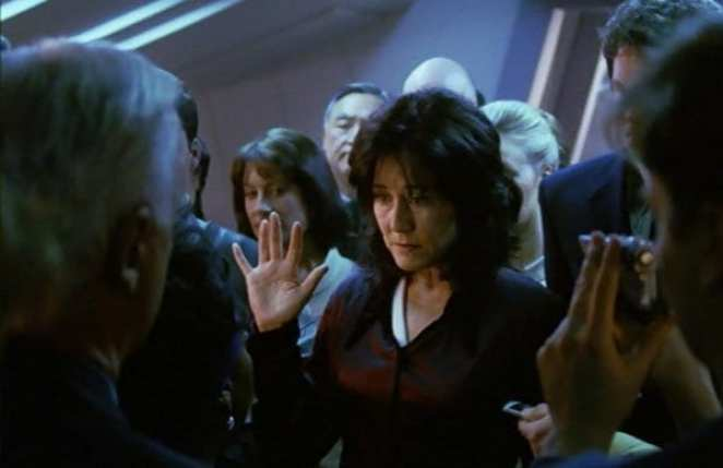 Laura Roslin (Mary McDonnell) takes the oath of office to become President of the Colonies in Battlestar Galactica