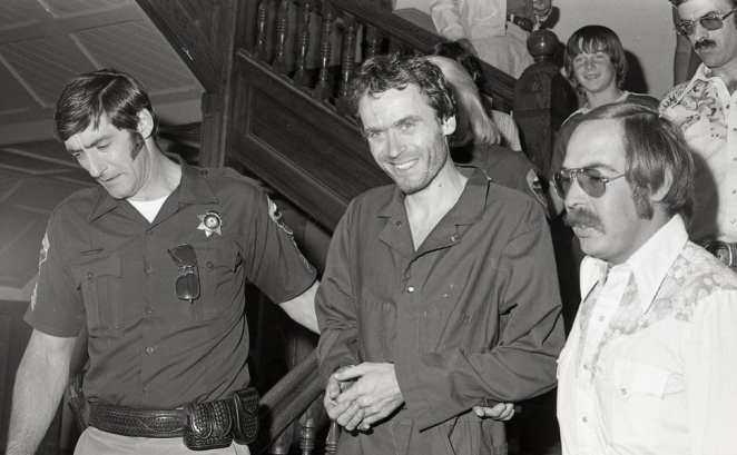 Ted Bundy is escorted out of court in Colorado