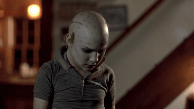 A young Tommy Jarvis tries to trick Jason Voorhees into believing he's just like him in Friday the 13th: The Final Chapter