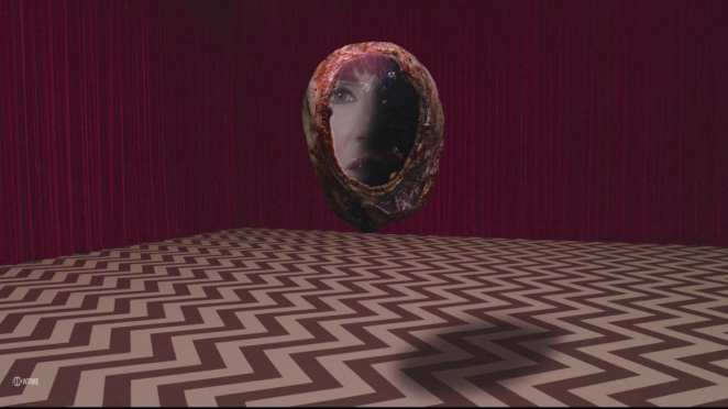 Dianes face within a blackened orb in the black lodge