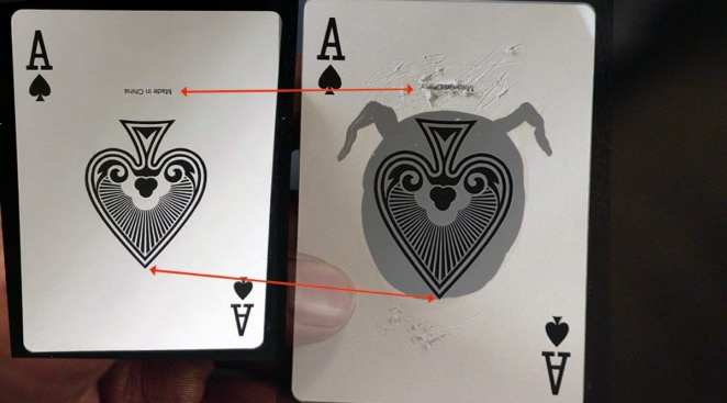 'Made in China' scratched off an Ace playing card