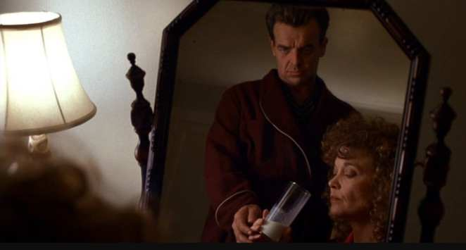 Leland and Sarah Palmer as she drinks a glass of milk.