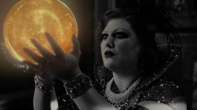 Senorita Dido holds the golden orb of Laura Palmer aloft