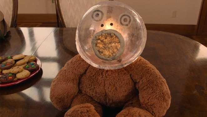 Johnny Horne's teddy with a glass orb head and a golden pool for a mouth with teeth
