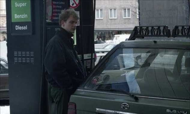 a man fills his car with gas in 71 Fragments of a Chronology of Chance (1994)