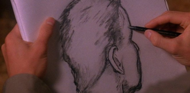 Andy draws the back of Leland's head as he sits in court