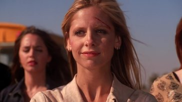 Buffy with tears in her eyes happily