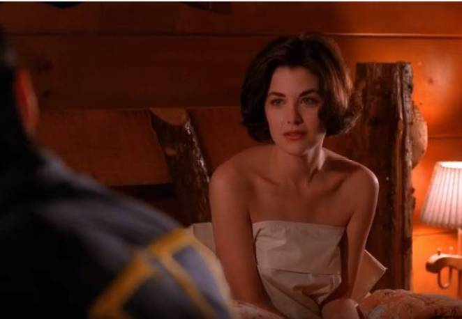 Audrey Horne sits up naked in a sheet