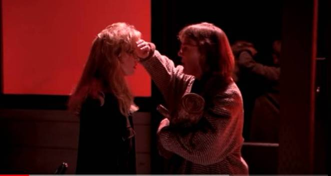 The Log Lady puts her hand to Laura's forehead