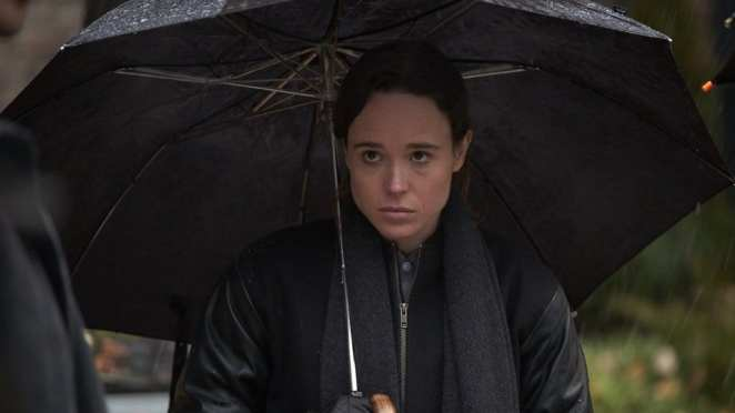 Ellen Page as Vanya Hargreeves standing under an umbrella