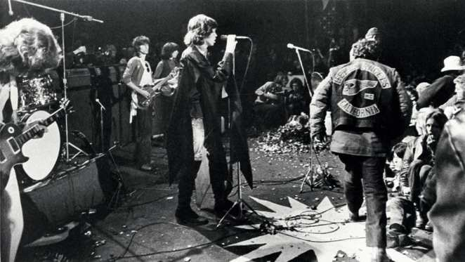 The Rolling Stones play at Altamont while the Hells Angels disrupt the show.