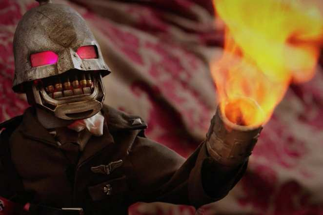 Kaiser burns his victims to a crisp in Puppet Master: The Littlest Reich