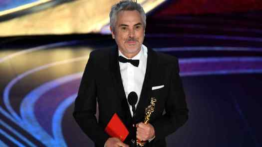 Alfonso Cuaron winning one of his three Oscars in 2019