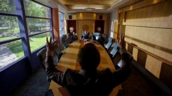 """Jimmy McGill interrupts Howard Hamlin's meeting in the HHM conference room in the Better Call Saul pilot episode """"Uno"""""""