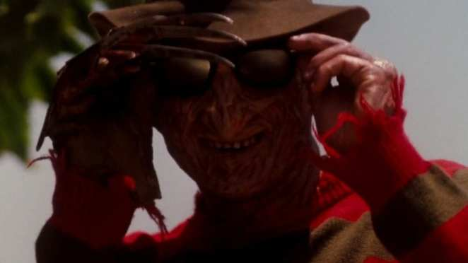 Freddy Krueger puts on sunglasses at a day on the beach in Dreamland.