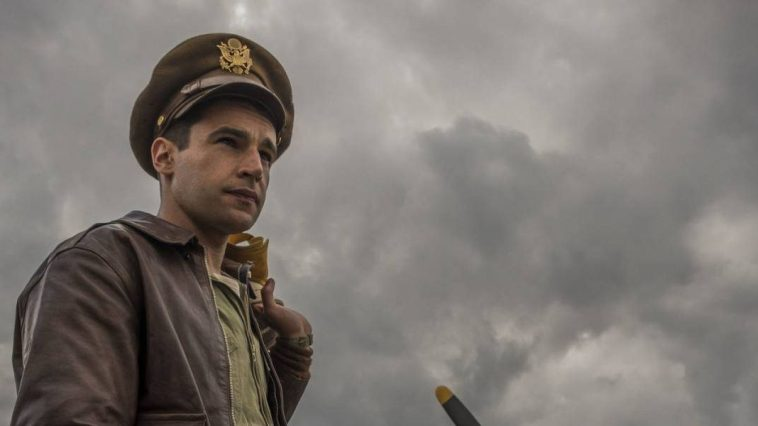 Yossarian wearing a hat with clouds in the sky