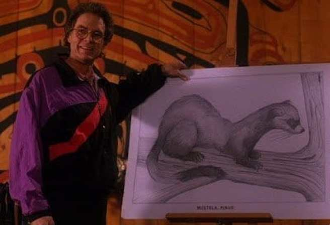 Ben Horne stands proudly beside a drawing of a pine weasel