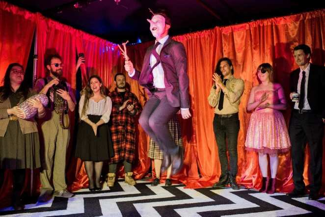 Actor of The Jumping Man center surrounded by the cast of Pink Room Burlesque.