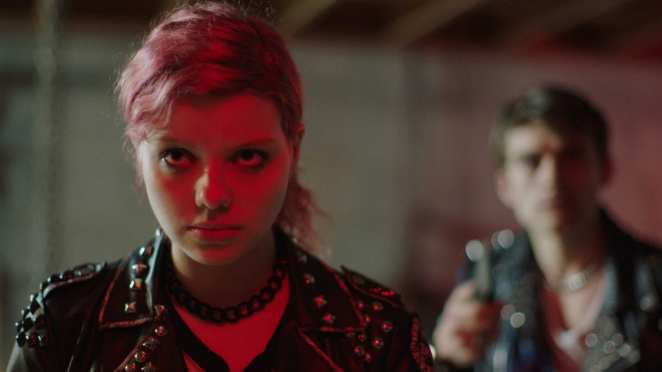 Chelsea (Chloe Levine) and her boyfriend in the punk scene of The Ranger, which utilizes bright colors when the film centers on the kids.
