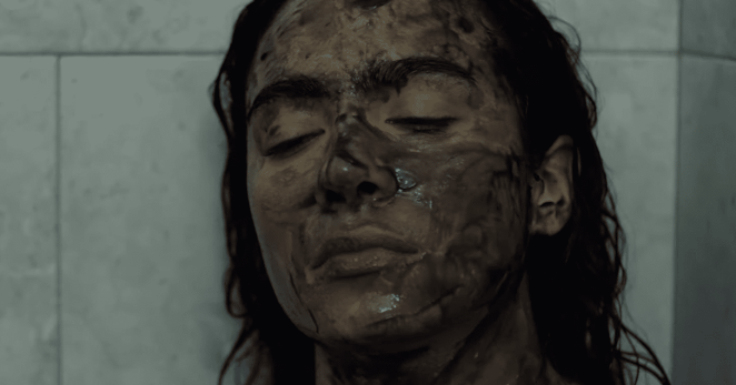 In this moment from All That We Destroy a clone of Ashley (Aurora Perrineau) just after creation at Dr. Harris home laboratory.