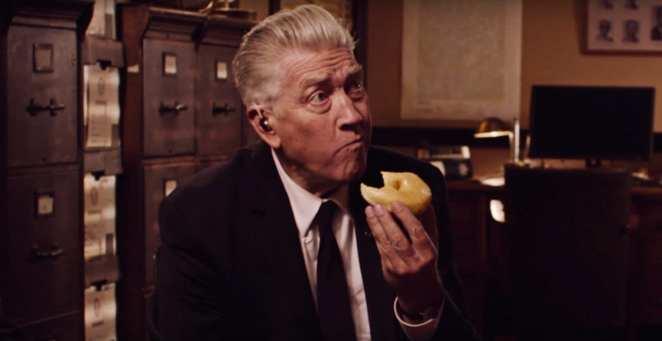 David Lynch eats a donut