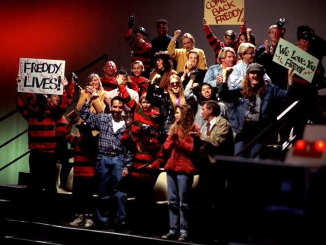 Audiences at a talk show cheer on Robert Englund as he surprises Heather Langenkamp in Freddy makeup in Wes Craven's New Nightmare.
