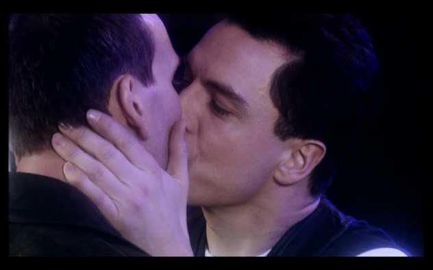 Captain Jack (John Barrowman) kisses the Doctor (Christopher Eccleston)