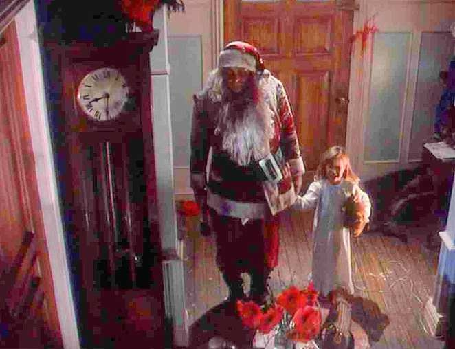 Killer Santa holds the daughter's hand in Tales from the Crypt