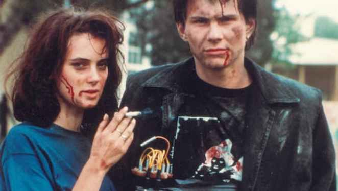 Winona Ryder (Veronica) and J.D. (Christian Slater) on the set of Heathers (1988).