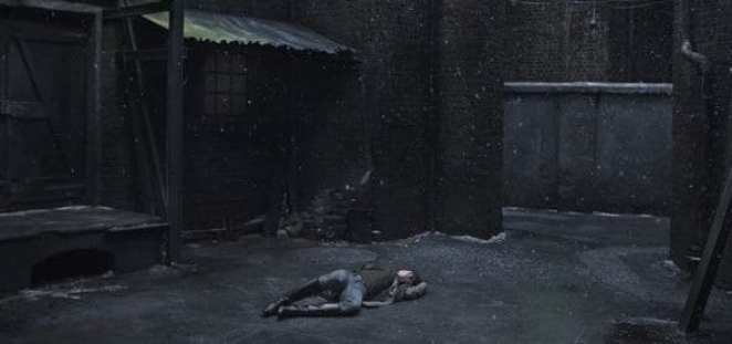 Protagonist from Lars von Trier's Nymphomaniac lying in alleyway