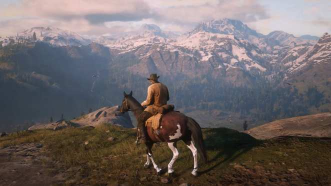 Riding on horseback taking in the scenery in Red Dead Redemption II