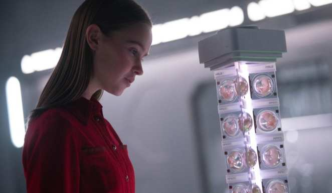 Daughter (Clara-Ruggard Larsen) looks at Mother's collection of human embryos that will become part of the new human race.