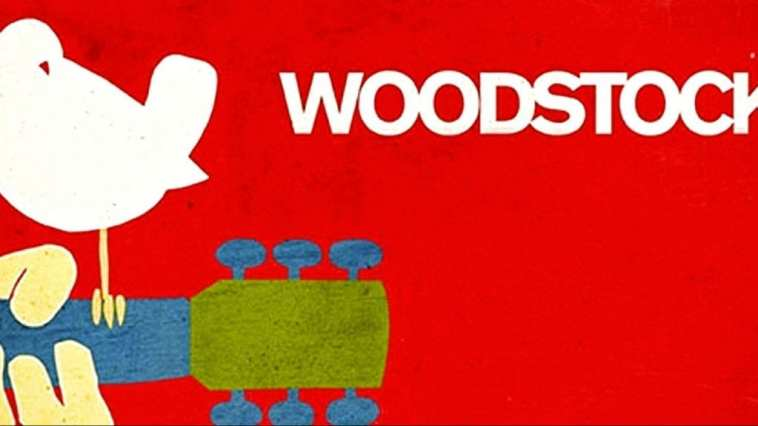 woodstock music festival logo featuring a white bird perched on the neck of a guitar with the word woodstock beside it