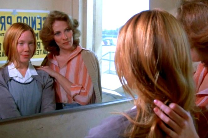 Miss Collins (Betty Buckley) proves to be a better maternal figure for Carrie White (Sissy Spacek) in Brian DePalma's Carrie (1976).