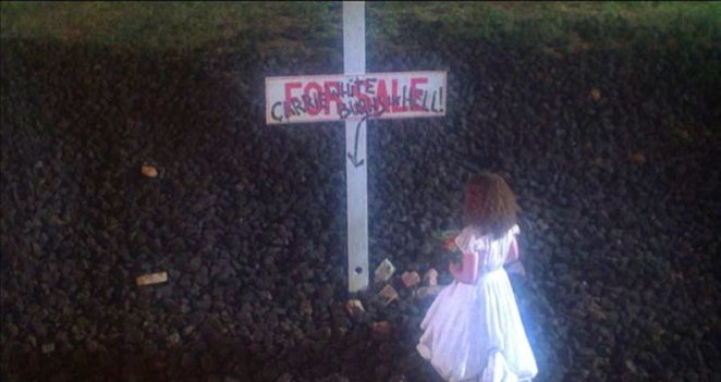 Sue Snell (Amy Irving) visits Carrie's grave in a dream sequence (and final jump scare) in Brian DePalma's Carrie (1976).