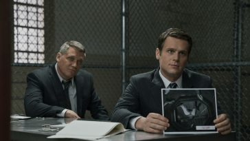 Bill Tench and Holden Ford sit at a table in prision in Mindhunter