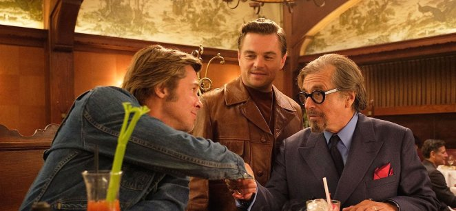 Leonardio DiCaprio and Brad Pitt and al Pacino in in the movie Once Upon a Time in Hollywood