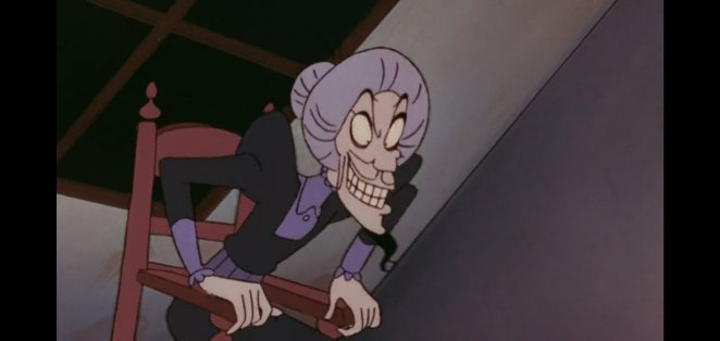Jafar as an old granny in a chair