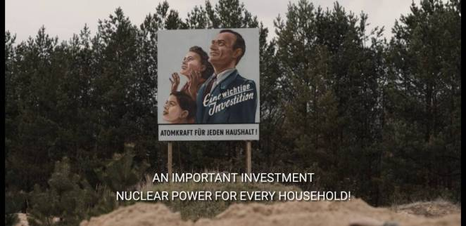 A sign next to a forest showing a nuclear family in Netflix's Dark