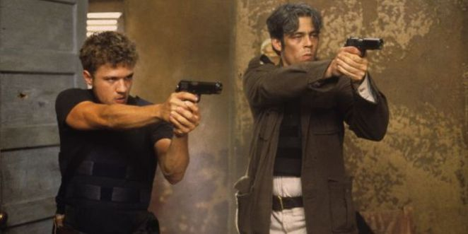 The two main characters point their guns at an unseen off-camera target