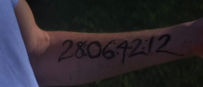 Donnie Darkos arm with the numbers 28064212 written in black marker