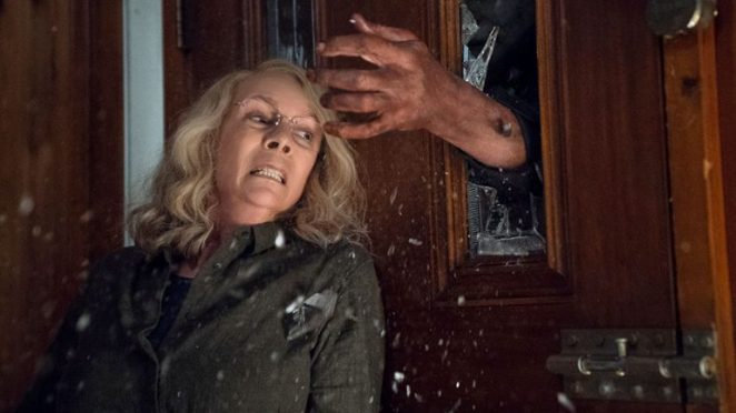 Laurie Strode (Jamie Lee Curtis) protects herself from Michael Myers in Halloween 2018